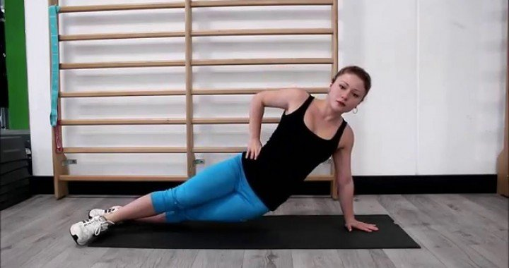 Six pack abs: Side Plank Exercise With Crossed Legs